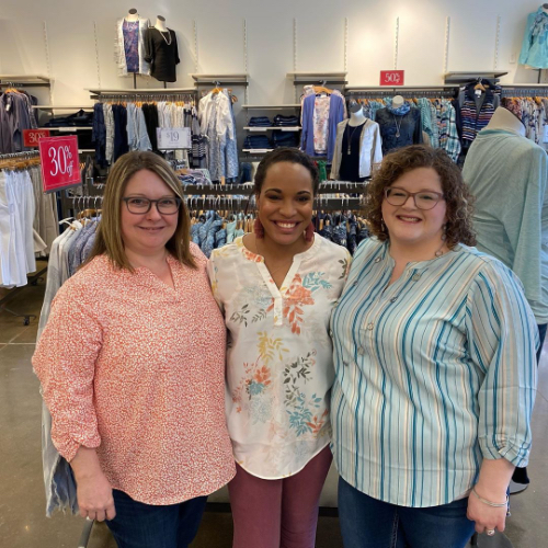 Christopher & Banks associates wearing a Two Tone Confetti Printed Blouse, a Pastel Floral Printed Blouseand a Variegated Stripe Blouse.