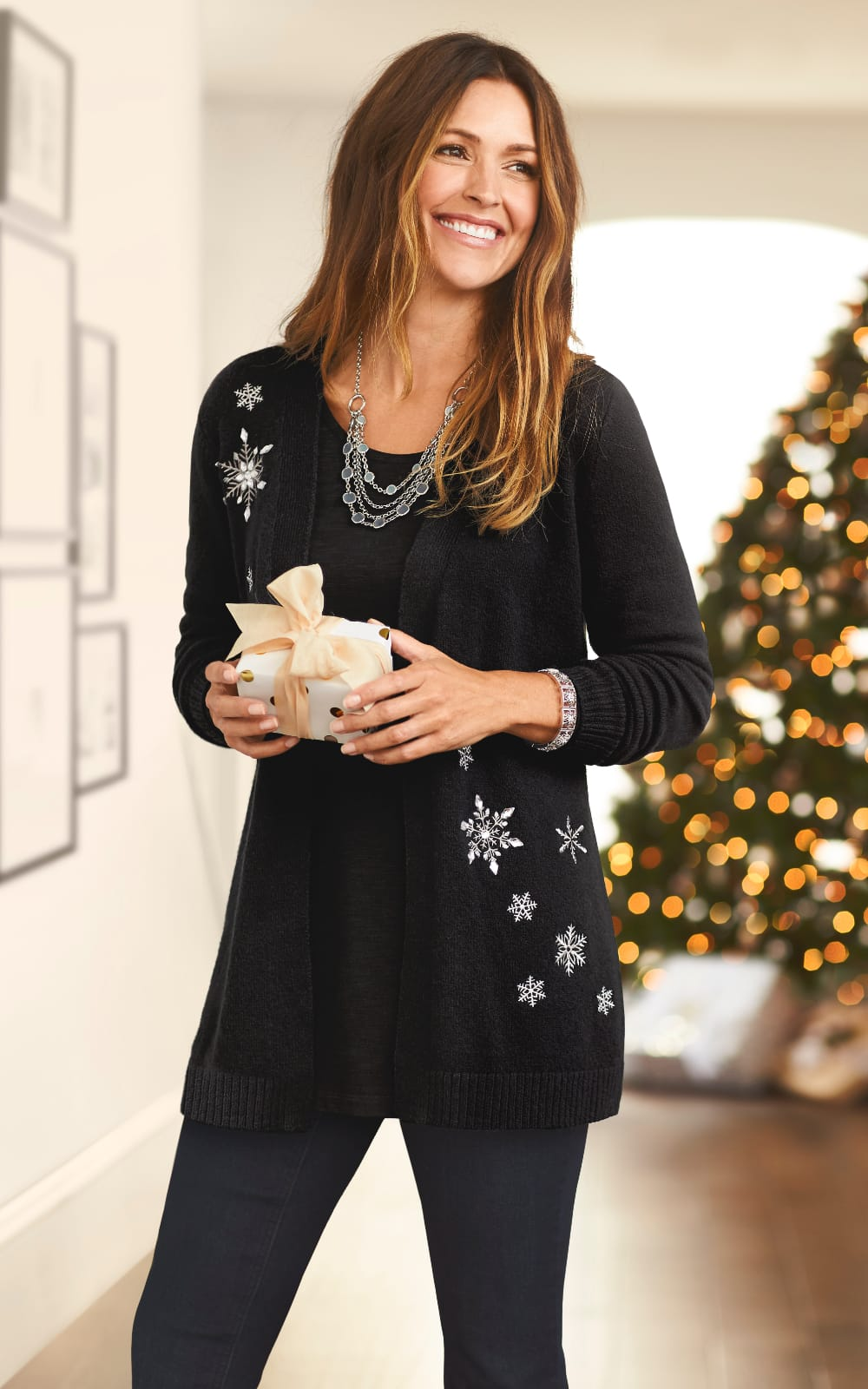 The 'Tis-the-Season Outfit: Featuring the Snowflake embellished cardigan, black essential tee, multi strand necklace, with a jean legging.