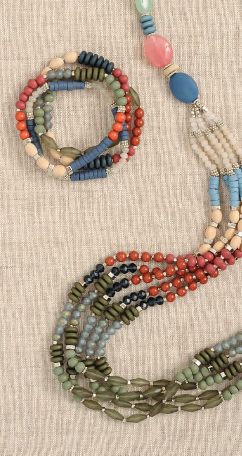 Our Accessories featuring a Long Beaded Statement Necklace and a Mixed Beaded Bracelet.