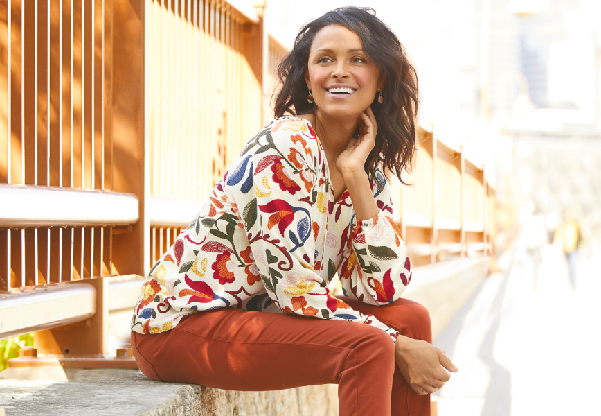 The Floral Blouse Outfit, including the Floral Printed Blouse, the Signature Slimming Ankle Jean, and the Filigree Drop Earring.