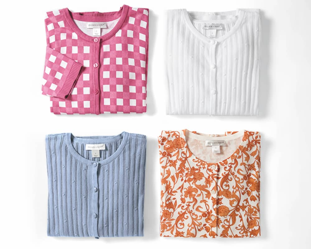 A comfortable array of our essential cardigans: a Perfect Textured Cardigan, a Perfect Textured Cardigan, and a Perfect Floral Printed Cardigan.