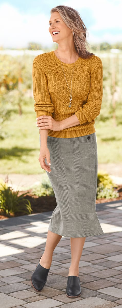 The Chic Sweater Outfit (combining the Tuck Stitch Novelty Pullover, the Plaid Button Detail Skirt, the Metal Hoop Earrings, and the Long Teardrop Metal Necklace).