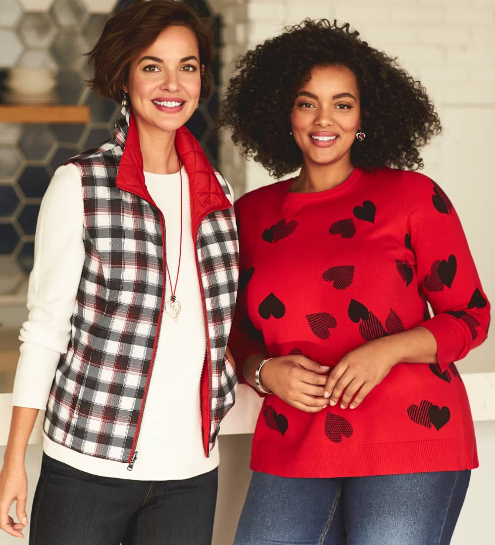 Our reversible buffalo plaid quilted vest, heart pendant necklace, and three-quarters-sleeve essential tee alongside our hearts pullover sweater.