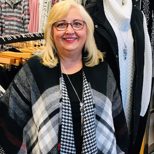 A Christopher & Banks Associate wearing a reversible Plaid Ruana.