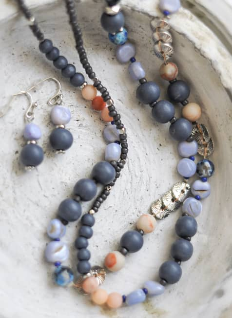 A beaded necklace and earring set.