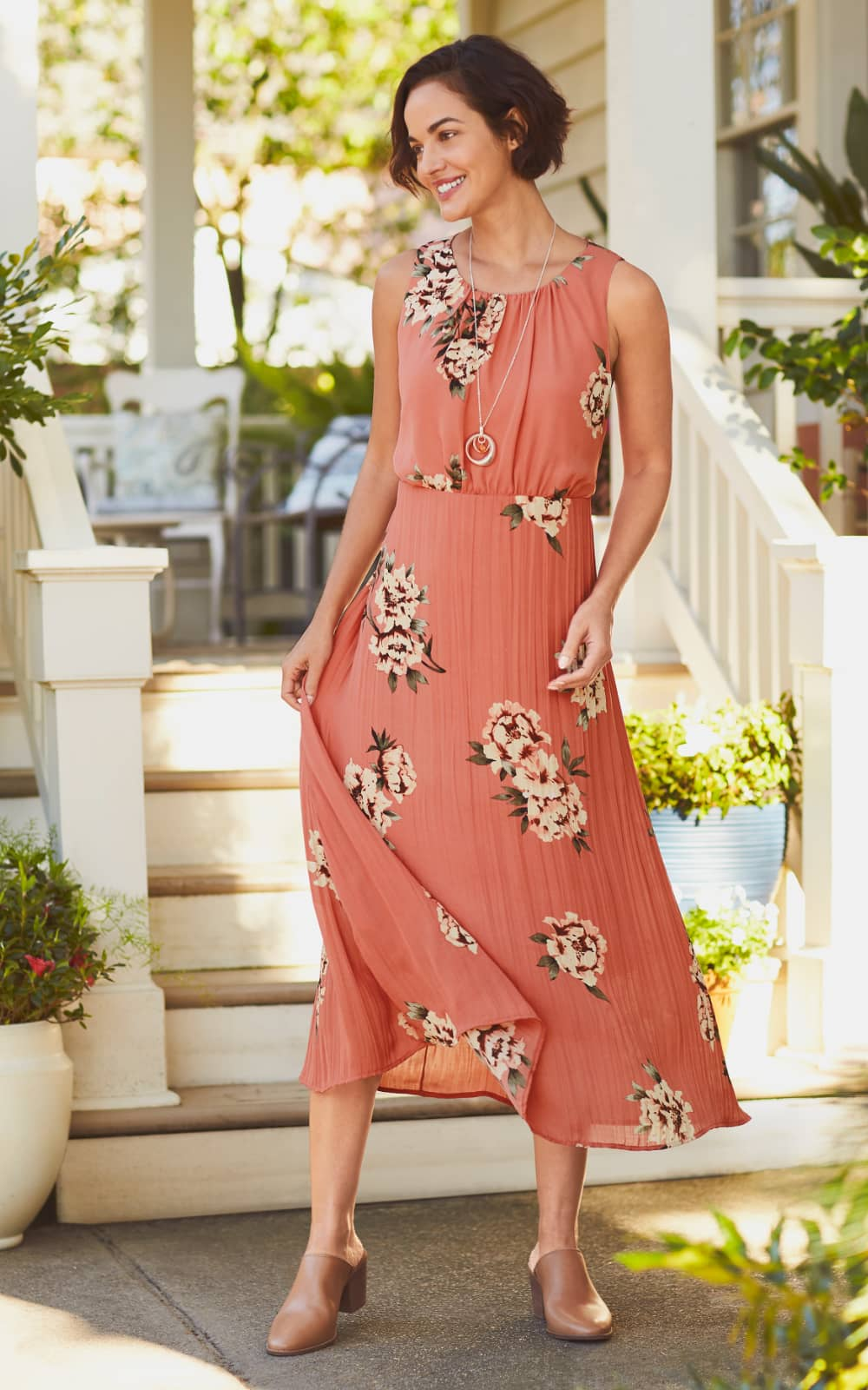 "The ""Sleeveless Floral Pleated Dress""."