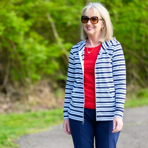"A Christopher & Banks blogger, ""Kay"", wearing a relaxed.Restyled.® Zip-Up Stripe Sweatshirt."