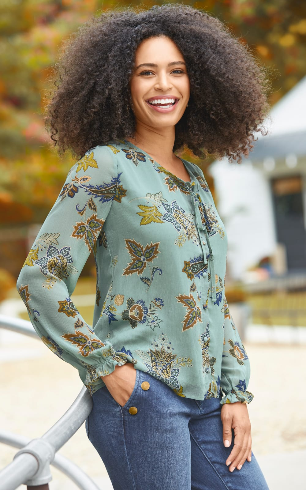 """Our """"Pretty-in-Prints"""" Outfit featuring our Spaced Floral Printed Blouse, Button Detail Straight Jean Average Shaped Fit, and Cutout Leaf Earrings."""