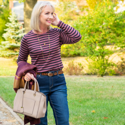 Our Blogger, Kay, wearing a long sleeve striped crew neck shirt.