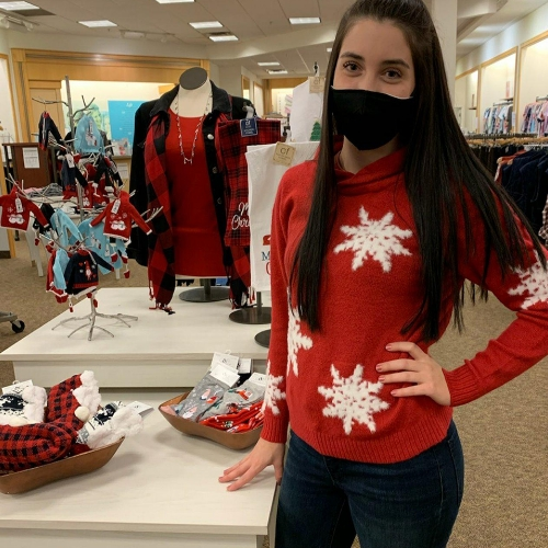 A Christopher & Banks Associate, wearing a Soft Snow Flake Plus Size Pullover Sweater.