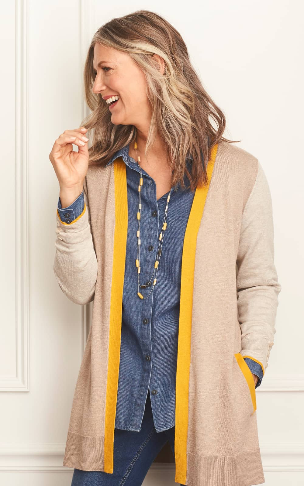 The A Touch of Sunshine Outfit, featuring a colorblock cardigan, mini stripe denim shirt, long double-layer beaded necklace, and jean legging.