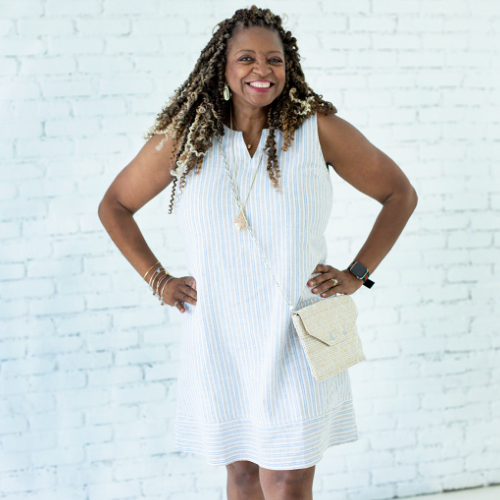 "A Christopher & Banks blogger, ""Val"", wearing a Sleeveless Striped Linen Blended Dress."